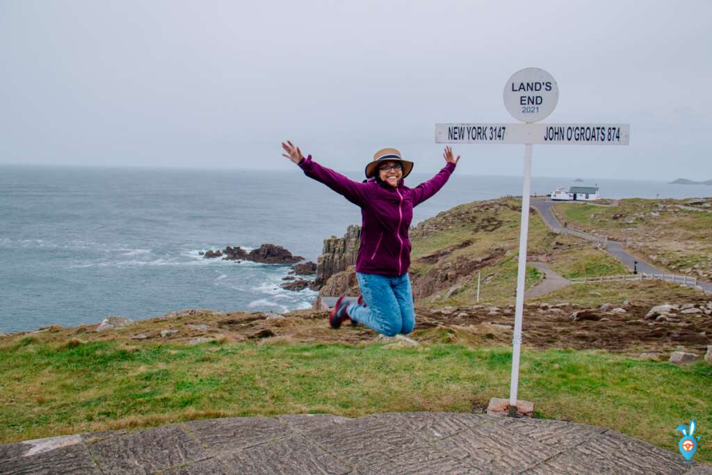 Jumping at Lands End signpost